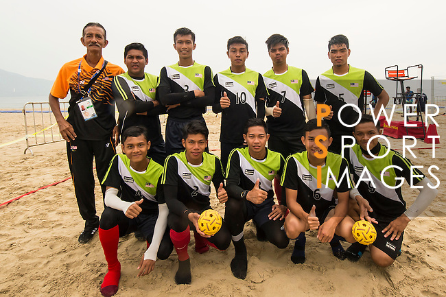 Malaysia Team's players pose for photos prior to the Beach Sepaktakraw Men's team competition between Korea Republic and Malaysia on Day Eight of the 5th Asian Beach Games 2016 at My Khe Beach on 01 October 2016, in Danang, Vietnam. Photo by Marcio Machado / Power Sport Images