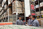 San Antonio Food Bank employees from left to right, Allan Montez, Jose Flores, and Luis Sierra, inventory recent donations. October 2, 2012. Copyright Lance Rosenfield / Prime