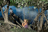 Xingu Indigenous Park, Mato Grosso State, Brazil. Aldeia Aweti. Sue in a canoe with a friend.