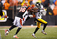 Antonio Brown #84 of the Pittsburgh Steelers is tackled by Shawn Williams #36 of the Cincinnati Bengals after catching a pass in the second quarter during the Wild Card playoff game at Paul Brown Stadium on January 9, 2016 in Cincinnati, Ohio. (Photo by Jared Wickerham/DKPittsburghSports)