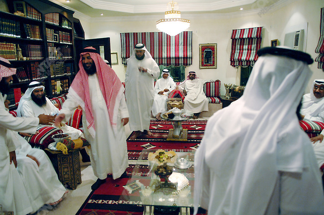 Sheik Adel Al-Nawada, a Salafi member of parliament, (seated 2nd from left), held a majlis at his home in Manama, the Bahraini capital, December 13, 2005.