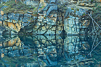 Reflection of rock cliff in Horseshoe Lake, Jasper National Park, Alberta, Canada