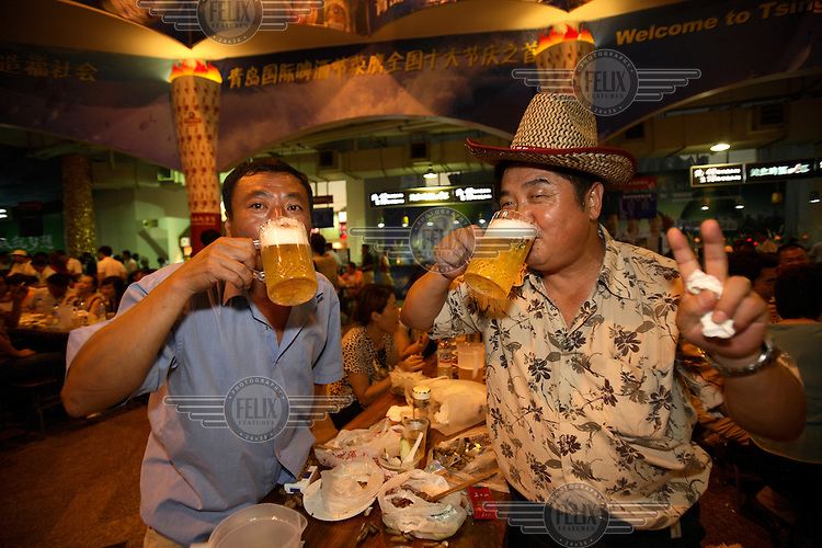Visitors enjoy themselves during the Qingdao Beer Festival. Qingdao is an ex-German colony that celebrates their own version of the Oktoberfest.