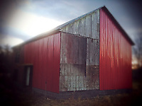 Red siding on old barn. iPhone photo. Manipulated with app.