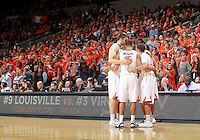 The Virginia team huddles during an NCAA basketball game Saturday Feb. 7, 2015, in Charlottesville, Va. Virginia defeated Louisville  52-47. (Photo/Andrew Shurtleff)
