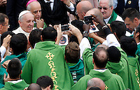 Papa Francesco saluta alcuni sacerdoti al termine di una messa con i catechisti in Piazza San Pietro, Citta' del Vaticano, 29 settembre 2013.<br /> Pope Francis greets priests at the end of a mass with catechists in St. Peter's Square, Vatican, 29 September 2013.<br /> UPDATE IMAGES PRESS/Riccardo De Luca<br /> <br /> STRICTLY ONLY FOR EDITORIAL USE