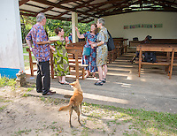 Occidental College professor Mary Beth Heffernan talks with retiring SIM Liberia director Will Elphick and his wife Jenny at their farewell gathering at the  ELWA Hospital in Monrovia, Liberia on Tuesday, Feb. 24, 2015. The Elphicks were going home to the UK after years of working in Liberia. <br /> (Photo by Marc Campos, Occidental College Photographer) Mary Beth Heffernan, professor of art and art history at Occidental College, works in Monrovia the capital of Liberia, Africa in 2015. Professor Heffernan was there to work on her PPE (personal protective equipment) Portrait Project, which helps health care workers and patients fighting the Ebola virus disease in West Africa.<br />