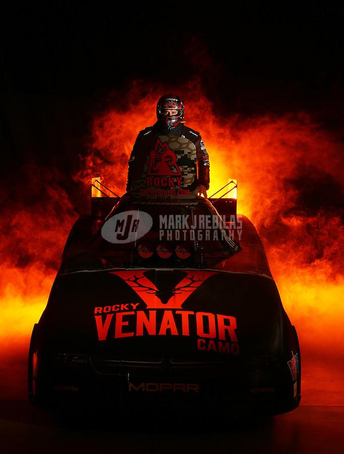 Jan 15, 2016; Brownsburg, IN, USA; NHRA funny car driver Matt Hagan poses for a portrait during a photo shoot at Don Schumacher Racing. Mandatory Credit: Mark J. Rebilas-USA TODAY Sports