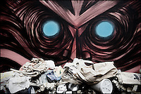 Street art by DanK overlooking rubbish, Shoreditch, East London