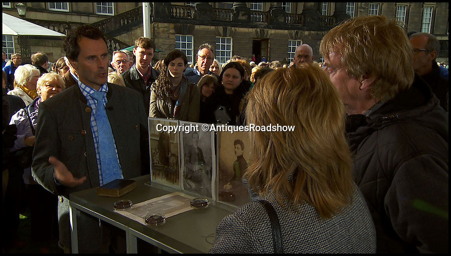 BNPS.co.uk (01202 558833)<br /> Pic: AntiquesRoadshow/BNPS<br /> <br /> Antiques Roadshow expert Adam Schoon, with collection owners Dorothy Rooney and Howard Holmes.<br /> <br /> The little-known story of the first professional black footballer to play in England over 100 years ago only to become a poor minner has emerged.<br /> <br /> Arthur Wharton was a teenage immigrant from the Gold Coast - Ghana - who came from a wealthy family and was sent to the UK for a Christian education.<br /> <br /> While here he developed into an incredibly talented athlete and excelled at running, football and cricket.<br /> <br /> After winning the AAA national championships for the 100 yard sprint, Arthur went on to become an accomplished goalkeeper.<br /> <br /> In 1888 he signed professional terms with Preston North End who played in the old Division One, what is now the Premier League.