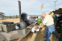 Mr. Hobby cooks ribs for his guest at a tail gate party before an NCAA football game, Saturday, December 06, 2014 in Waco, Tex. (Mo Khursheed/TFV Media via AP Images)
