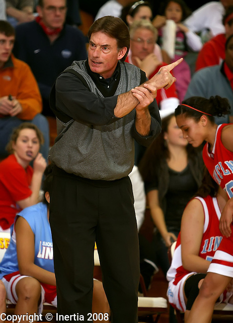 SIOUX FALLS, SD - DECEMBER 16:  SIoux Falls Lincoln girls head basketball coach Lyle Pearson calls out a play at a game against Roosevelt. (Photo by Dave Eggen/Inertia)