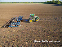 63801-10118 Farmer tilling field before planting corn-aerial Marion Co. IL