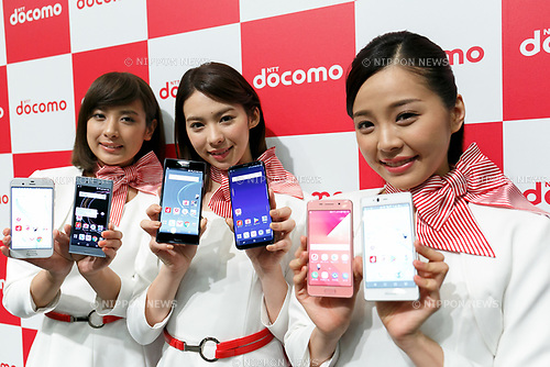 Models hold DOCOMO new mobile devices during the summer lineup launch event on May 24, 2017, Tokyo, Japan. DOCOMO introduced seven new smartphones and one tablet along with a new app and service plans. (Photo by Rodrigo Reyes Marin/AFLO)