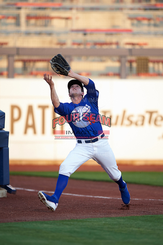 Tulsa Drillers outfielder Adam Law (15) catches a foul ball during a game against the Midland RockHounds on June 2, 2015 at Oneok Field in Tulsa, Oklahoma.  Midland defeated Tulsa 6-5.  (Mike Janes/Four Seam Images)