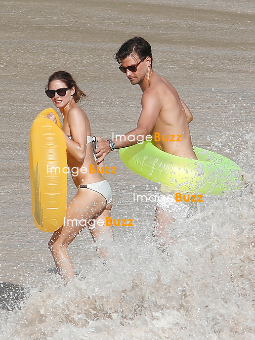 Olivia Palermo and Johannes Huebl very much in love while sunbathing at the beach and playing with rubber rings in the waves in Saint Barths.<br /> January 11, 2014.