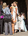 The Wedding of Poppp Delevingne and James Cook<br /> St Paul's Church, Knightsbridge 17.5.2014<br /> Sister Cara Delevingne with holds young child in a onesie