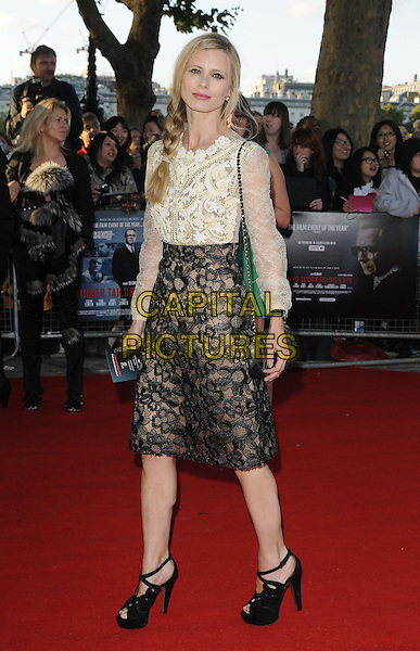 "LAURA BAILEY .The ""Tinker, Tailor, Soldier, Spy"" UK premiere, BFI  Southbank cinema, Belvedere Rd., London, England..September 13th, 2011.full length black lace skirt sandals shoes white cream blouse top sheer braid plait  .CAP/CAN.©Can Nguyen/Capital Pictures."