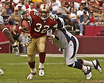 San Francisco 49ers running back Kevan Barlow (32) runs through line on Sunday, September 15, 2002, in San Francisco, California. The Broncos defeated the 49ers 24-14.