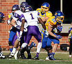 BROOKINGS, SD - OCTOBER 24:  Kyle Paris #32 from South Dakota State looks for room past Deiondre' Hall #1 from University of Northern Iowa in the first quarter of their game Saturday afternoon at Coughlin Alumni Stadium in Brookings. (Photo by Dave Eggen/Inertia)