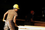 Lumber yard with male workers sorting wood planks near Darrington Washington State USA
