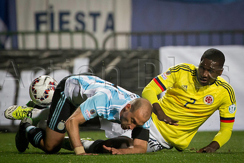 27.06.2015. Vina Del Mar, Chile,  Argentinas  Pablo Zabaleta (L) challenges with Colombias Cristian Zapata during the quarter-final match between Argentina and Colombia at the Copa America Chile 2015 in the El Sausalito Stadium, in Vina del Mar city, Chile, on June 27th,  2015.
