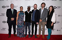 "NEW YORK CITY - APRIL 22: (L-R) Gary E. Knell , Adjani Costa, Tumeletso ""Water"" Setlabosha, Neil Gelinas , Steve Boyes and Clara Wu Tsai attend National Geographic's ""Into The Okavango"" Screening at Tribeca Film Festival at Tribeca Festival Hub on April 22, 2018 in New York City. (Photo by Anthony Behar/National Geographic/PictureGroup)"