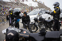 Suzanne Lee filming at the World's Highest Motorable Road, Khardung La, with the Sony ActionCam POV cameras while on a motorcycle ride Across the Indian Himalayas with Sanjit Das on Royal Enfield motorcycles. Photo by Sanjit Das/Panos Pictures