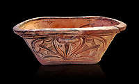 Minoan  pottery bath tub larnax decorated with a stylised crocus flower ,  Episkopi-Lerapetra 1350-1250 BC, Heraklion Archaeological  Museum, black background.<br /> <br /> To the Greeks, the Underworld was entered by water. As with many other Minoan bathtubs, this one was probably later used as a coffin to convey the deceased across the sea, where marine imagery would be equally appropriate. The two functions of bathtubs, bathing and burial, combine in the story of Agamemnon who, on return from Troy, was murdered by his wife and her lover in a silver bath.