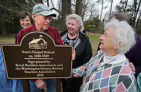 NWA Democrat-Gazette/DAVID GOTTSCHALK  Susan Shelton McRay (right), former student at the Son's Chapel School, visits Monday, March 19, 2018, with Jim Carson, a former student, during the formal dedication of a sign marking the school's location on the grounds of Son's Chapel in Fayetteville. The one room school existed from 1880-1949. The sign was placed by the Rural Builders Association, founded in 1922, and the Washington County Retired Teachers Association.
