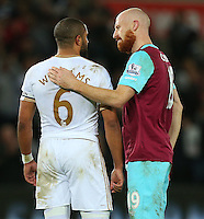 Ashley Williams of Swansea City and James Collins of West Ham United hug at full time during the Barclays Premier League match between Swansea City and West Ham United played at The Liberty Stadium, Swansea on 20th December 2015