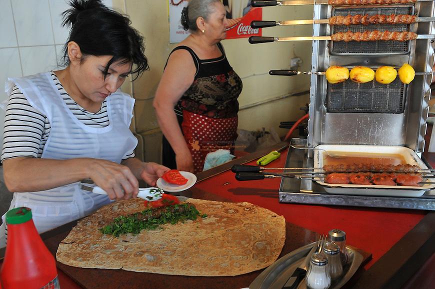 Women preparing Kebab for cooking