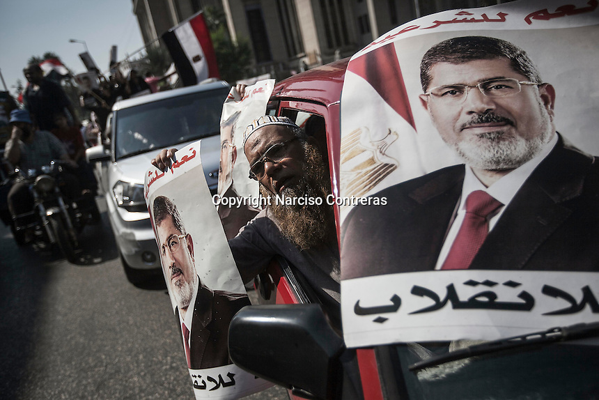 In this Friday, Aug. 02, 2013 photo, supporters of the ousted president Mohammed Morsi march towards Al-Rabaa Alawya mosque through the nearby streets in Cairo. (Photo/Narciso Contreras).