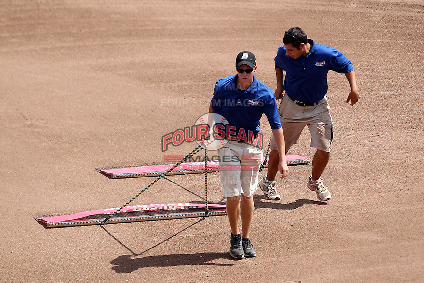 Buffalo Bisons grounds crew drags the field during a game against the Toledo Mudhens at Coca-Cola Field on August 17, 2011 in Buffalo, New York.  Buffalo defeated Toledo 4-2.  (Mike Janes/Four Seam Images)