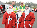 Colm Maher and Adrian Cooney of St John's Ambulance pictured with Dylan Cleeland, Evan Byrne and Ben Flanagan who took part in the Santa Dash. Photo: Colin Bell/pressphotos.ie