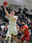 SPEARFISH, SD: DECEMBER 30:  Fraser Malcolm #24 of Black Hills State drives past Donovan Oldham #4 of CSU Pueblo during their game Saturday evening at the Donald E. Young Center in Spearfish, S.D.   (Photo by Dick Carlson/Inertia