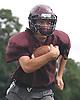 Ryan Aughavin, North Shore quarterback, runs the ball on a keep during varsity football team practice at North Shore High School in Glen Head on Thursday, Aug. 18, 2016.