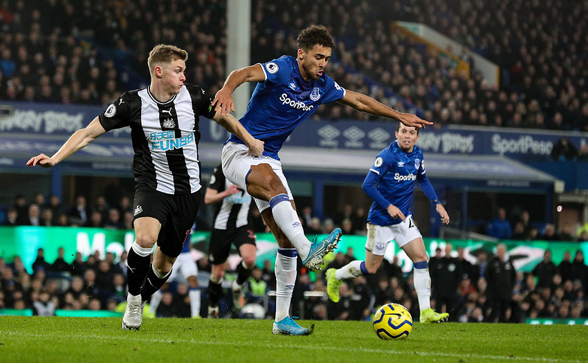 Everton's Dominic Calvert-Lewin battles with Newcastle United's Emil Krafth<br /> <br /> Photographer Alex Dodd/CameraSport<br /> <br /> The Premier League - Everton v Newcastle United  - Tuesday 21st January 2020 - Goodison Park - Liverpool<br /> <br /> World Copyright © 2020 CameraSport. All rights reserved. 43 Linden Ave. Countesthorpe. Leicester. England. LE8 5PG - Tel: +44 (0) 116 277 4147 - admin@camerasport.com - www.camerasport.com