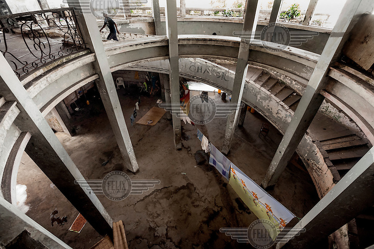 The circular staircase in the entrance hall of the former Grand Hotel building. Once a luxury destination for the wealthy and the continent's biggest hotel, the building is now a concrete shell and home to about 6,000 squatters. Those unable to occupy one of the rooms sleep in the corridors, basements and even on the roof of the building.