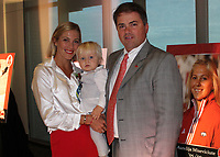 NWA Democrat-Gazette/CARIN SCHOPPMEYER Aurelija Miseviciute-Merrill and Michael Merrill, with baby Hudson Merrill, attend the UA Sports Hall of Honor on Sept. 13.