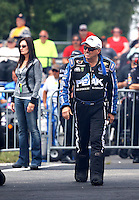 Jun 6, 2015; Englishtown, NJ, USA; NHRA funny car driver John Force with wife Laurie Force during qualifying for the Summernationals at Old Bridge Township Raceway Park. Mandatory Credit: Mark J. Rebilas-