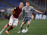 Calcio, andata degli ottavi di finale di Champions League: Roma vs Real Madrid. Roma, stadio Olimpico, 17 febbraio 2016.<br /> Roma's Radja Nainggolan, left, is challenged by Real Madrid's Toni Kroos, during the first leg round of 16 Champions League football match between Roma and Real Madrid, at Rome's Olympic stadium, 17 February 2016.<br /> UPDATE IMAGES PRESS/Isabella Bonotto