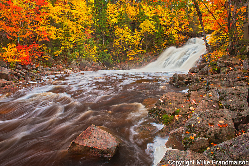 Mary-Anne Falls in the Acadian forest in autumn foliage <br />