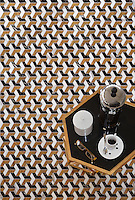 Francois, a waterjet mosaic shown in polished Saint Laurent, Calacatta Tia, and Topaz Onyx, is part of the Illusions™ collection by Sara Baldwin for New Ravenna.