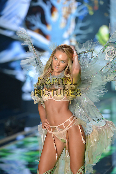 LONDON, ENGLAND - DECEMBER 02: Candice Swanepoel walk the runway at the annual Victoria's Secret fashion show at Earls Court on December 2, 2014 in London, England. <br /> CAP/PL<br /> &copy;Phil Loftus/Capital Pictures