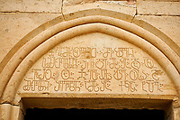 Close up picture &amp; image of a Georgian inscription on the main entrance to David Gareja Georgian Orthodox monastery, Mount Gareja, Kakheti Region, Georgia (country)<br /> <br /> Founded in the 6th century by David (St. David Garejeli), one of the  thirteen Assyrian monks who built monasteries throughout Georgia. The monastery is spread out over a huge area of the arid Mount Gareja, with small cells and chapels cut into cliff faces