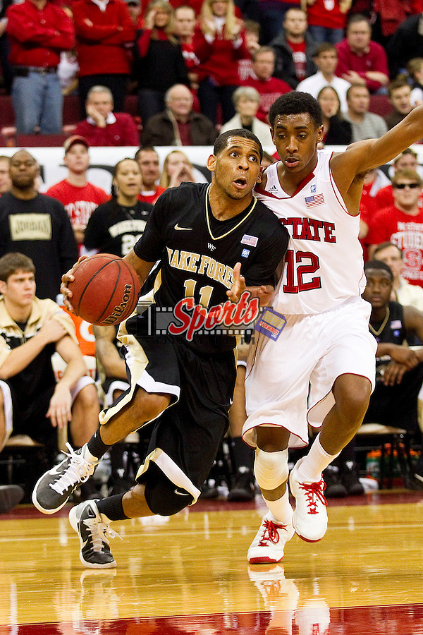 C.J. Harris #11 of the Wake Forest Demon Deacons drives the baseline past Ryan Harrow #12 of the North Carolina State Wolfpack at the RBC Center on January 8, 2011 in Raleigh, North Carolina.  The Wolfpack defeated the Demon Deacons 90-69.  Photo by Brian Westerholt / Sports On Film