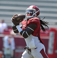 NWA Democrat-Gazette/MICHAEL WOODS &bull; @NWAMICHAELW<br /> University of Arkansas running back Alex Collins  runs drills during practice Saturday, August 15, 2015 at Razorback Stadium in Fayetteville.