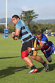Peter Roache takes little notice of Lolhea Loco's attempted tackle. Counties Manukau Premier Club Rugby game between Ardmore Marist and Weymouth, played at Bruce Pulman Park on May 14th 2016. Ardmore Marist won the game 43 - 7 after leading 17 - 0 at halftime. Photo by Richard Spranger.