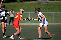 Action from the National Lacrosse Championships women's match between Auckland Senior (white) and Waikato (red and yellow) at Wakefield Park in Wellington, New Zealand on Sunday, 18 March 2018. Photo: Dave Lintott / lintottphoto.co.nz